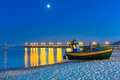 Baltic beach with fishing boat at night Royalty Free Stock Photo