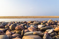 Baltic beach stones blue sky with and Royalty Free Stock Photo