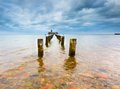 Baltic rocky coast with old military buildings from world war ii and wooden breakwaters beautiful view on Royalty Free Stock Photo