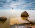 Baltic rocky coast with old military buildings from world war ii and wooden breakwaters beautiful view on Royalty Free Stock Image