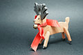 Bambi with red loop a wooden christmas ornaments Royalty Free Stock Photo