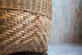 Bamboo basket handmade placed on the marble floor. Royalty Free Stock Photo