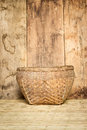 Bamboo basket on mat weave and wood board background picture Stock Image