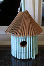 Bamboo birdhouse made of with thatch roof Stock Images