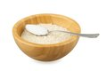 Bamboo bowl with rice and steel spoon with salt Stock Photography