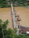 Bamboo bridge cross the canal in lao Stock Photo