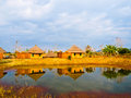 Bamboo cottages and and thier reflections in pond in nakorn ratc ratchasima thailand Stock Image