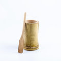 Bamboo cup with bamboo spoon for outdoor life or camping on white background Royalty Free Stock Photos