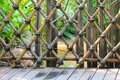 ฺฺbamboo fence old bamboo and wood porch protecting from river Stock Image