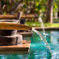 Bamboo fountain and water splash Stock Photography