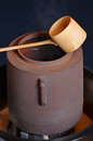 Bamboo ladle and kettle Royalty Free Stock Photo
