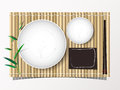 Bamboo mat and dish and chopsticks set lunch top view bakcground Royalty Free Stock Photo