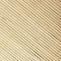 Bamboo mat pattern background texture yellow beige surface diagonal square format Royalty Free Stock Photo