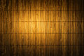 Bamboo mat straw background wood matting texture dark yellow wall Stock Images