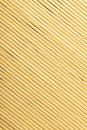Bamboo mat surface pattern diagonal background texture yellow beige square format Royalty Free Stock Photography