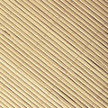 Bamboo mat surface pattern diagonal background texture yellow beige square format Royalty Free Stock Images