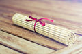 Bamboo mat for sushi with a bow photo of Stock Photo