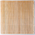 Bamboo mat for sushi straw colored background close up studio shoot Royalty Free Stock Images
