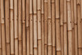 Bamboo old brown wall background the horizontal Royalty Free Stock Images