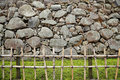 Bamboo pole fench grass turf and irregular shaped stone wall green old of japanese castle Stock Photography
