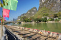 Bamboo raft coloured flags and li river Royalty Free Stock Photography