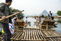 Bamboo rafting along Yulong River during the winter season with beauty of the landscape is a popular activity in Guilin.