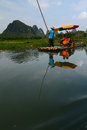 Bamboo rafting on the li river reflections of by karst peaks of yangshuo china Stock Image