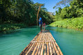 Bamboo river tourism in jamaica boat and captain on martha brae Royalty Free Stock Image