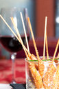 Bamboo skewer with fried king prawns in a restaurant Stock Image