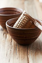 Bamboo tea strainer in a ceramic cup close up Royalty Free Stock Image