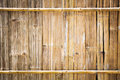 Bamboo texture close up old and dirty board used as rural house wall Royalty Free Stock Photo