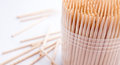 Bamboo toothpicks round in plastic container white background Stock Images