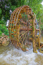 Bamboo water wheel the use of power for irrigation thailand Royalty Free Stock Images