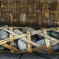 Bamboo weaved container full of pebbles called Longshi Royalty Free Stock Photo