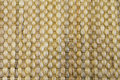 Bamboo woven beige mat handmade background. Royalty Free Stock Photo