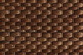 Bamboo woven brown mat handmade background. Wicker wood texture. Royalty Free Stock Photo