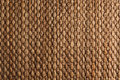 Bamboo woven brown mat handmade background. Royalty Free Stock Photo