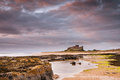 Bamburgh Castle after dawn Royalty Free Stock Photo