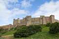 Bamburgh castle northumberland england grade listed bulding building and popular tourist attraction Royalty Free Stock Photo