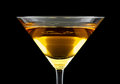 Banana bliss cocktail consisting of cognac and creme de bananas isolated on black background Royalty Free Stock Images