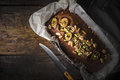 Banana cake in the baking form  on the wooden table top view Royalty Free Stock Photo