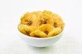 Banana chips in bowl Royalty Free Stock Photo