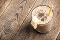 Banana chocolate smoothie glass on wooden table Royalty Free Stock Photo