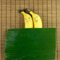 Banana couple lovely sleeping on bamboo mat with leaf as blanket Stock Photos