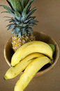 Banana fruit bowl brown background Stock Photography