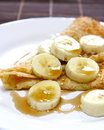 Banana and maple syrup pancake Stock Photos