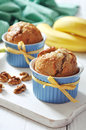 Banana muffins in ceramic baking mold with yellow ribbon over wooden background Stock Images
