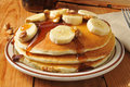 Banana nut pancakes with maple syrup Royalty Free Stock Photos