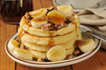 Banana nut waffles a stack of with maple syrup Stock Photo