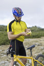 Banana recovery mountain bike sport cyclist eating looking for potassium Stock Photos
